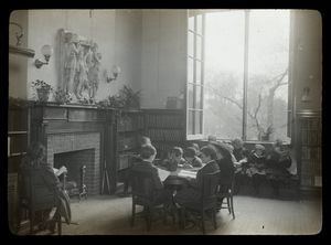 Harlem branch, fireplace in Children's room, window at right open, children reading, April 8, 1910