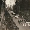 Suffrage parade marching north on Fifth Avenue at 26th Street.]