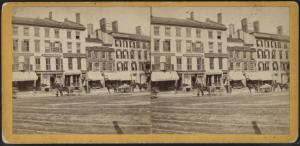 [Commercial street with printer, insurance company, and hotel.]