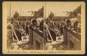 [View of masons laying bricks on National Hotel in Salina.]