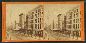 [Street scene showing buildings and street tracks.]