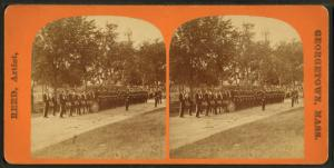 [Men in uniform, some with drums.]