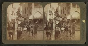 "Picturesque natives of Egypt in the crooked streets of ""Cairo,"" World's Fair, St. Louis."