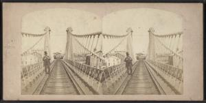 Niagara Suspension Bridge. [Man in a top hat standing on railroad tracks.]