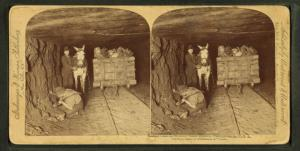 Mining coal three miles under ground, Pennsylvania, U.S.A.