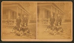 [Group portrait of two men and three women taken in front of the porch.]