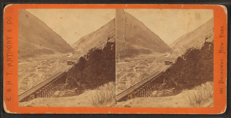 Lower Weber Canyon, looking west, Devil's Gate bridge in the foreground. Union Pacifc Railroad.