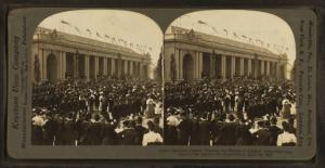 Military parade passing the Palace of Liberal Arts. Opening day at the Jamestown Exposition, April 26, 1907.