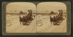 Six-horse tally-ho leaving mountain walled Gardiner for trip through Yellowstone Park, U.S.A.