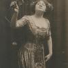 Sophie Tucker holding a rose, at the American Music Hall.