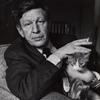 W. H. Auden (seated with cat)