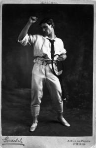 Nijinsky with a tennis raquet in hand in 'Jeux.'