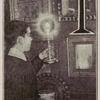 I.  [Boy holding a candle.]