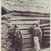 Dennis and John Hanks standing beside the old Lincoln home. 1865