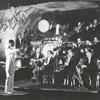 Far shot of Jimmie Lunceford and his orchestra during a performance; Sy Oliver on trumpet