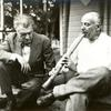 Henry Cowell demonstrating shakuhachi to Varese
