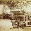 Inside a factory.]