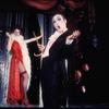 Unidentified actress and Joel Grey in the stagte production Cabaret.