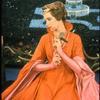 Julie Andrews holding a rose in Camelot