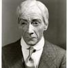 """Clifton Webb as """"John D. Rockefeller, Sr."""" in the stage production As Thousands Cheer."""