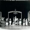 "Ula Sharon and Carl Randall (center stage) in the ""Alice in Wonderland"" scene in the stage production Music Box Revue."
