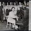 Irving Berlin entertains WACs [Women's Army Corps] in New Guinea.
