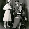 """Mary Wickes, unidentified actor and Monty Woolley (in wheelchair) in The Man Who Came to Dinner."""