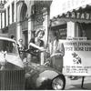 Gypsy Rose Lee signing an autograph outside of theatre hosting her show A Curious Evening with Gypsy Rose Lee.