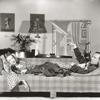 "Gertrude Lawrence and Noel Coward on sofa in ""Private Lives."""