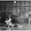 Carol Lawrence cradling Larry Kert surrounded by cast members in the stage production West Side Story