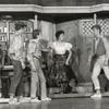 Chita Rivera as Anita confronts the Jets gang (pictured includes Lee Becker, David Winters, Tony Mordente, and Art Smith) in the stage production West Side Story