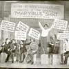 Philip Loeb and unidentified cast holding picket signs in a scene from Let 'em Eat Cake