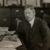 Portrait of Frank Sprague seated at desk