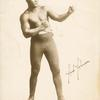Jack Johnson in boxing stance.
