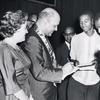 Robert C. Weaver signing autographs after receiving the National Association for the Advancement of Colored People's Spingarn Award, in Atlanta, Georgia, July 1962