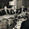 Dinner party for Robert C. Weaver at the Waldorf Astoria Hotel, New York City, 1961. Seated left to right in background: Colonel Campbell C. Johnson, Dr. Ralph J. Bunche, Weaver, Judge William H. Hastie and Roy Wilkins.