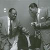 """Count Basie, Billie Holiday and Billy Eckstine, holding Holiday's chihuahua """"Peppy"""""""