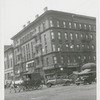 View of the northwest corner of West 135th Street and Lenox Avenue, with the West 135th Street Branch of The New York Public Library (Schomburg Center) at left, 1920s