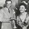 "Billie Holiday (right) with Louis Armstrong in publicity photograph for the 1947 film ""New Orleans."""