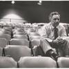 Elia Kazan sitting alone in an empty auditorium.