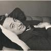 Elia Kazan smiling and lying on sofa.
