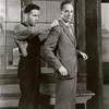 Humphrey Bogart (as Duke Mantee) measuring Leslie Howard (as Allan Squire) in The Petrified Forest.