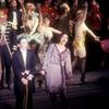 Bert Convy, Joel Grey, and cast in the stage production Cabaret.