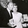 Angela Lansbury holding her Tony Award for Dear World and unidentified man at the 1969 Tony Awards