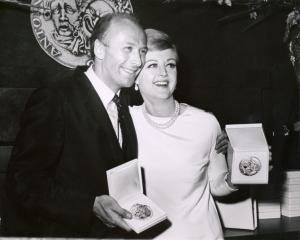Angela Lansbury holding her Tony Award for Dear World and unidentified man at the 1969 Tony Awards