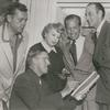 Unidentified man, producer Bill Doll, playwright Ouida Rathbone, director Reginald Denham, and Basil Rathbone during preparation for the stage production Sherlock Holmes