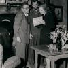 Director George Cukor examining script with Robert Mitchun and Greer Garson on the set of the motion picture Desire Me