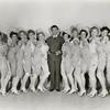 Publicity photo of Robert Taylor and chorus girls in This is My Affair