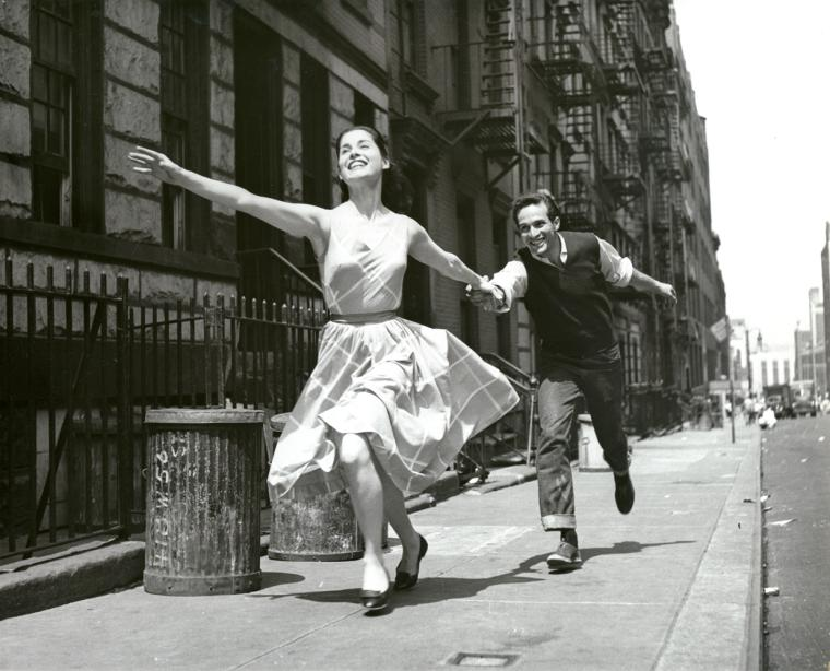 Carol Lawrence and Larry Kert running down the street in promotional photo for West Side Story.