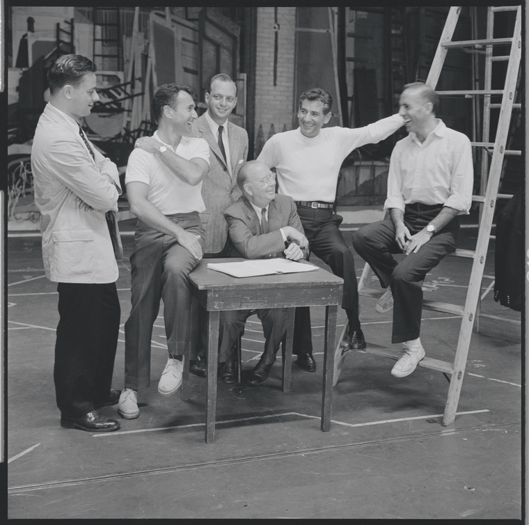 Stephen Sondheim, Arthur Laurents, Hal Prince, co-producer Robert Griffith (seated), Leonard Bernstein and Jerome Robbins on the set of West Side Story.